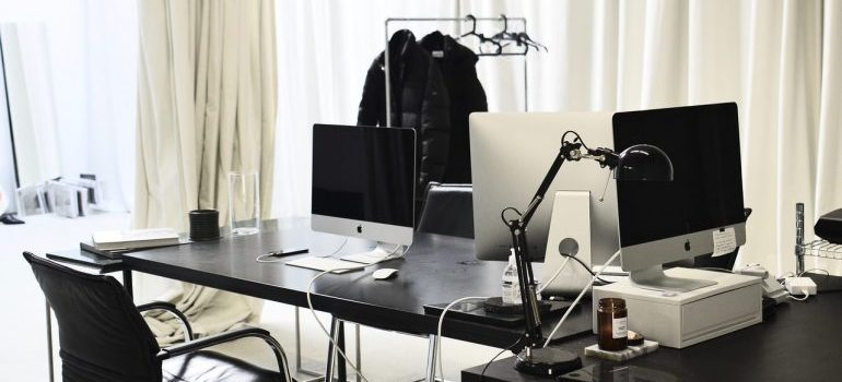 Workspace with modern convenient computers in daytime