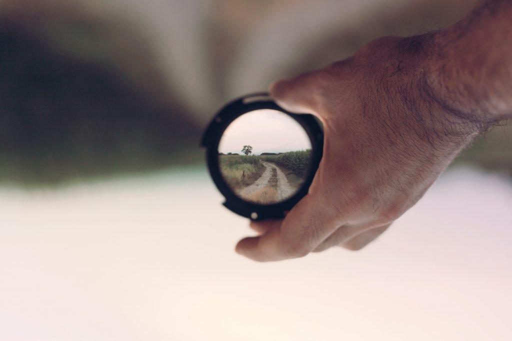 Man holding a lens.