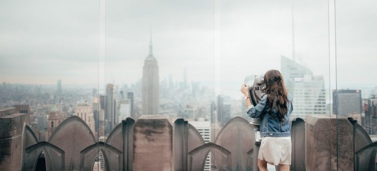 Girl in NYC looking at the Empire State Building