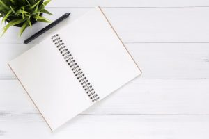 Picture of a notebook and pencil. You should plan the moving budget you need in Brooklyn in advance