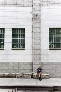 girl sitting in front of the building