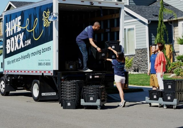 People loading a moving truck - if you don't know how to do it, the DIY method is not always the cheapest option
