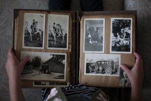 Photo album with black-and-white family photos.