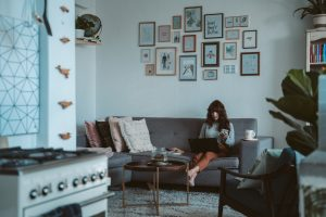 girl thinking what to leave behind when downsizing