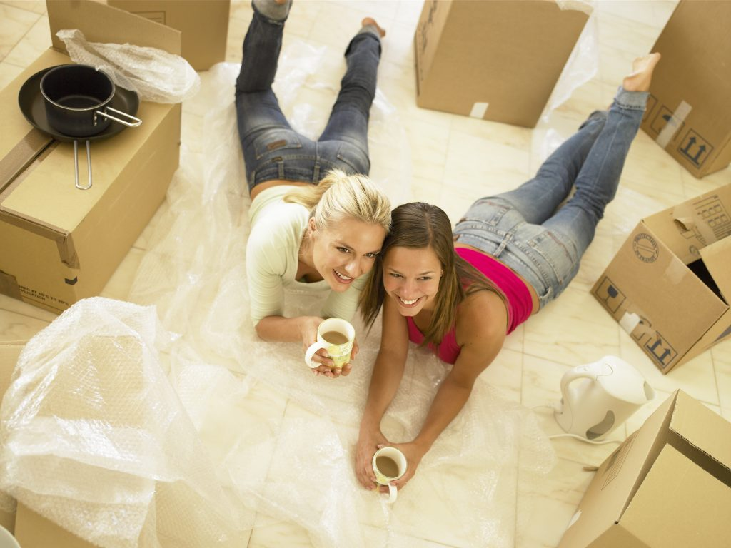 Women with moving boxes