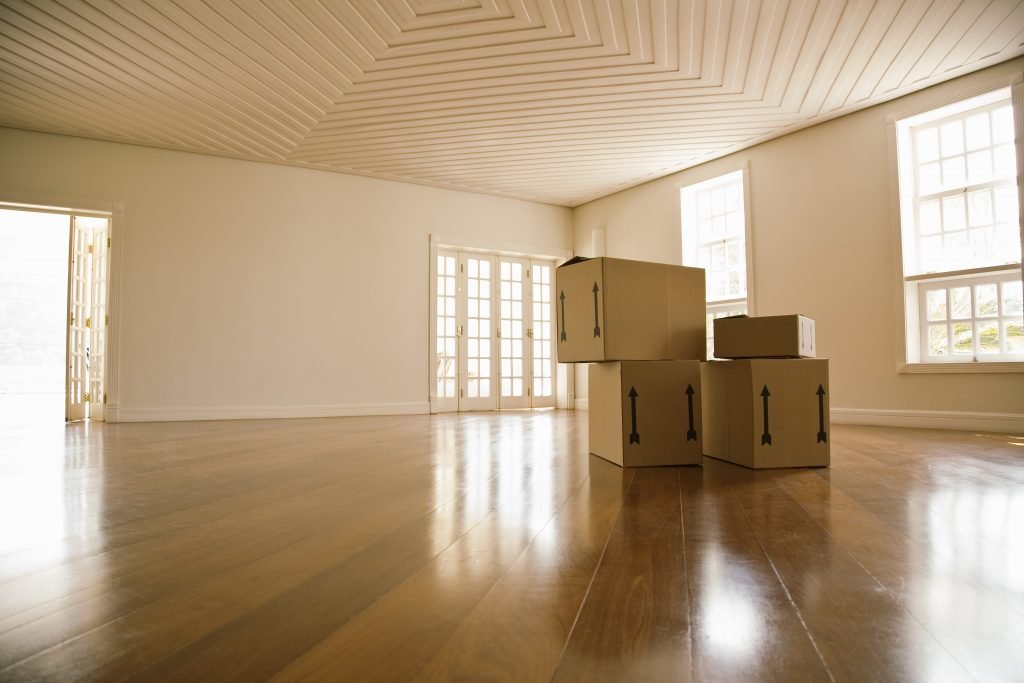 moving boxes in an empty room, representing moving tips NYC