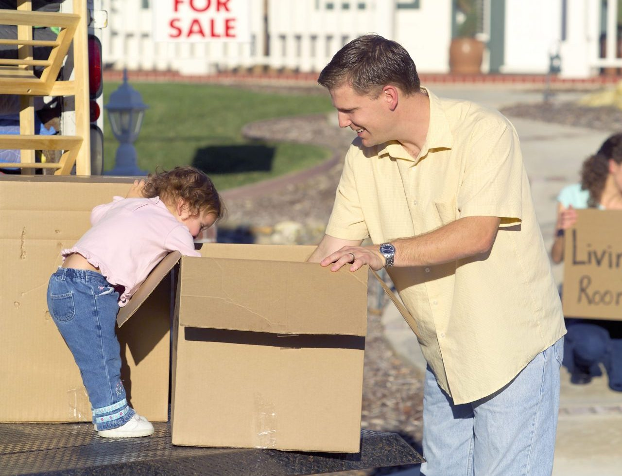 father and a daughter with a moving box