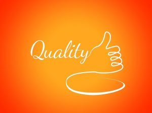 The word quality written in white on an orange background, with a drawn thumbs up gesture next to it.