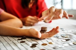 man and woman stacking pennies
