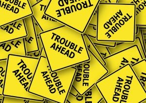 A lot of yellow warning signs that have trouble ahead written on them. You should file a complaint against a moving company at the first sign of trouble.
