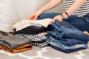 Piles of clothes made when moving to a smaller place