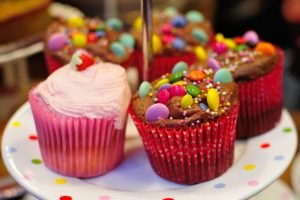 A close-up of colorfully decorated cupcakes.