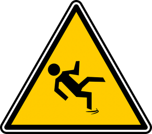 A sign with a person falling