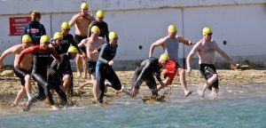 swimmers entering the ocean