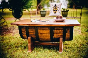 A close-up of a rustic wooden table in the middle of the garden. The possibility to store wood furniture has never been easier than in the recent years.