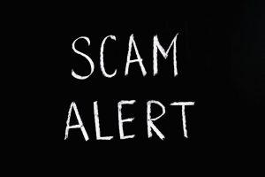Black backgorund with scam alert wirtten in white