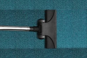 A vacuum cleaner on a rug