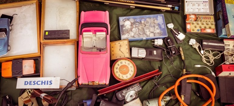 A bunch of vintage items for sale in a garage sale