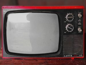 A red vintage TV that can create pricing issues with moving companies.